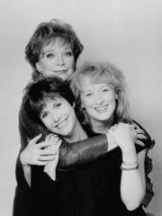 "Shirley MacLaine, Carrie Fisher and Meryl Streep pose for a photo. MacLaine and Streep starred in ""Postcards from the Edge,"" a film based on Fisher's novel of the same name. Fisher also wrote the screenplay."