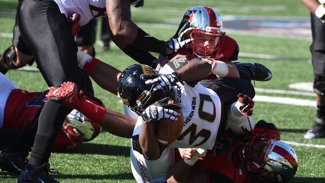 Southern Miss running back Jalen Richard (30) scores a touchdown in the first half against Western Kentucky Saturday in the Conference USA Championship.