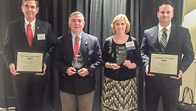 Robertson County Director of Schools Mike Davis, Vice Chair Stoney Crockett, Board Chair Connie Hogan and Architect Jason Morris display the district's TSBA honors.