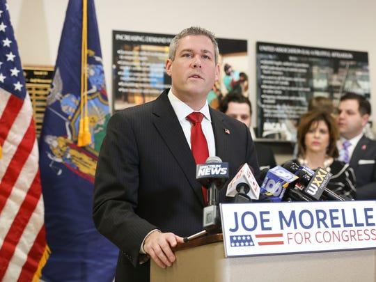 Monroe County Clerk Adam Bello introduced Joseph Morelle