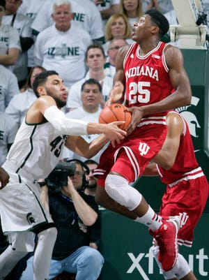 Michigan State's Denzel Valentine, left, steals the ball from Indiana's Emmitt Holt during the first half of MSU's 70-50 win Monday night.