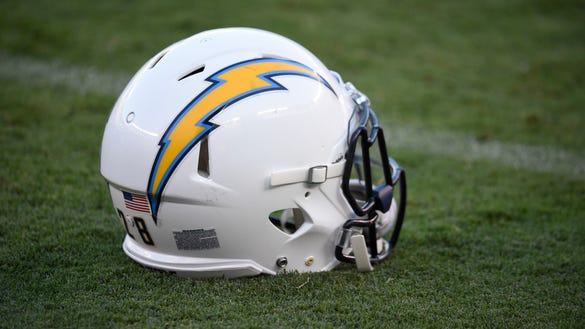 A San Diego Chargers helmet sits on the field before
