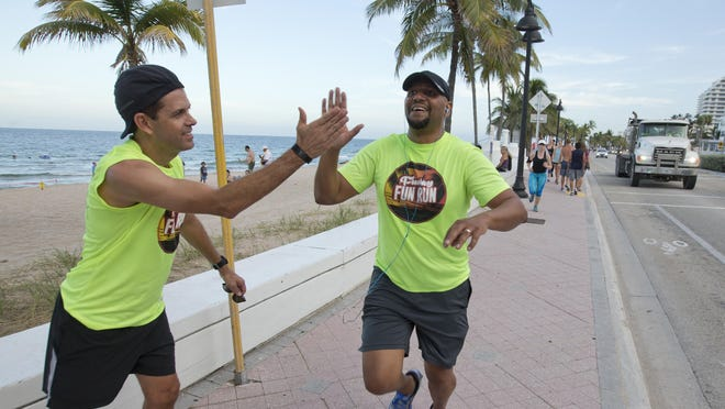 Don Wennerstrom, left, congratulates Andre Lattibeaudiere on a run this month in Fort Lauderdale, Fla. Lattibeaudiere used the Westin resort's run club to connect with his then-boss earlier this year. Later, the club helped him connect with the Westin's general manager, and he ended up getting a job there.