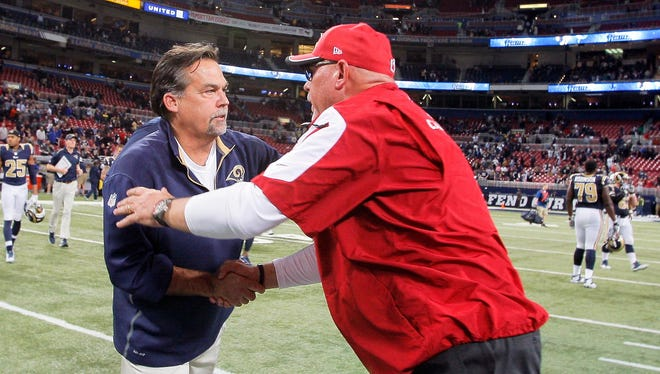Dec 11, 2014: St. Louis Rams head coach Jeff Fisher and Arizona Cardinals head coach Bruce Arians shake hands after the game between the two teams at the Edward Jones Dome. The Cardinals defeated the Rams 12-6.