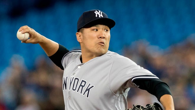 New York Yankees starting pitcher Masahiro Tanaka throws during the first inning of a baseball game against the Toronto Blue Jays in Toronto, Friday, March 30, 2018.
