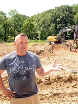 Pastor Josh George talks about progress on his 12,000 square-foot Quinebaug River Church Tuesday off School Street in Jewett City. See video at NorwichBulletin.com