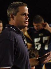 Delta coach Grant Zgunda addresses his players in 2004.