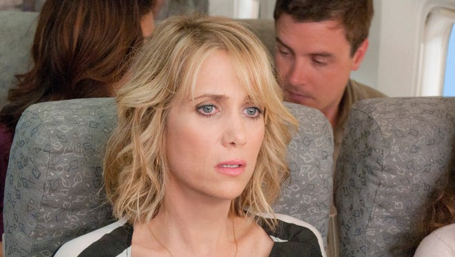 "Kristen Wiig is freaked out by flying  in a scene from the movie ""Bridesmaids."""