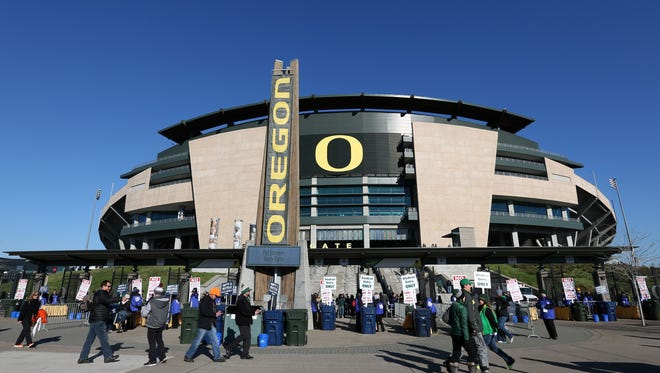 Three Oregon football players were hospitalized during recent offseason workouts.