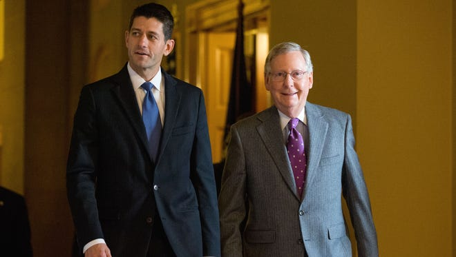House Speaker Paul Ryan, R-Wis., left, walks with Senate Majority Leader Mitch McConnell, R-Ky.