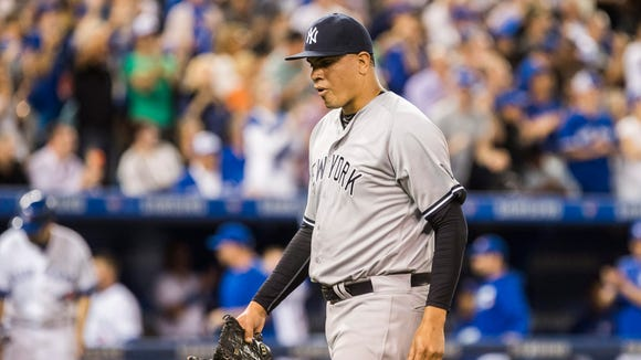 New York Yankees pitcher Dellin Betances walks to the dugout during the seventh inning of a baseball game against the Toronto Blue Jays on Tuesday, May 31, 2016, in Toronto.