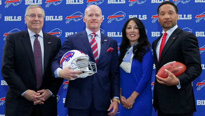 Terry Pegula, coach Sean McDermott, Kim Pegula and Doug Whaley.