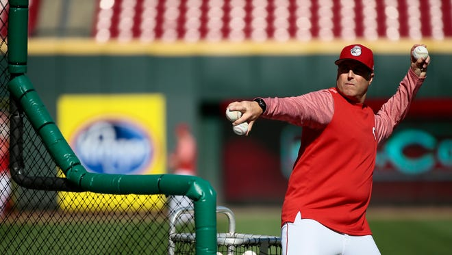 Cincinnati Reds manager Bryan Price (38) pitches during batting practice before the game.
