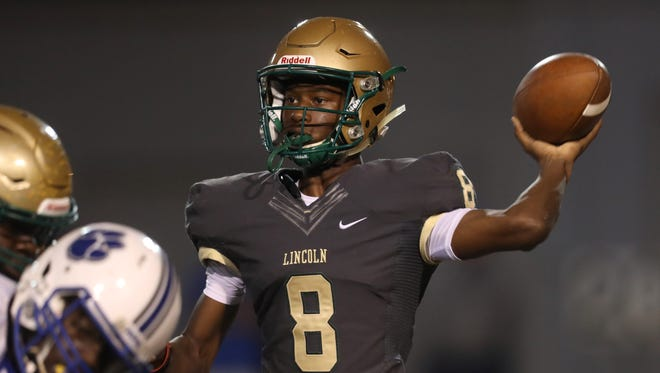 Lincoln's Chris Beard throws the ball against Godby during their game at Cox Stadium on Friday.