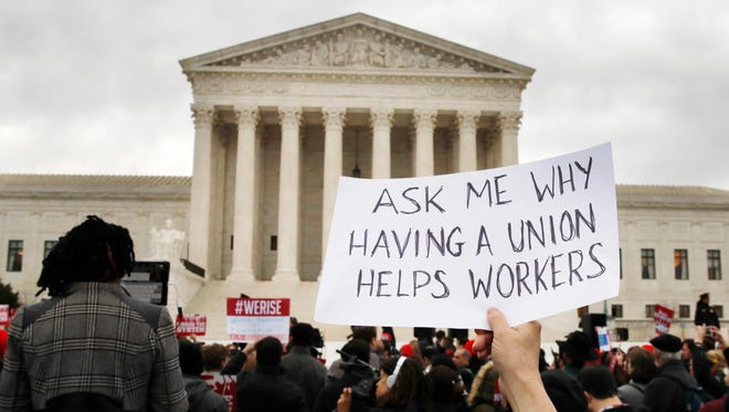 Union members demonstrated outside the Supreme Court in February as the justices heard a major challenge to the power of public employee unions.