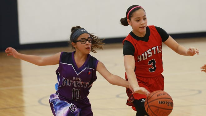 Monique Moya of Team Infinity, left, tries to steal the ball from Hustle's Victoria Perez during a basketball game at the Acosta Center. Teams are preparing to play in the upcoming regional basketball tournaments in El Paso.