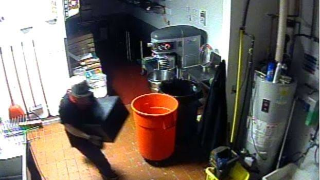 Surveillance cameras caught a suspect stealing from Jet's Pizza in Little Chute.