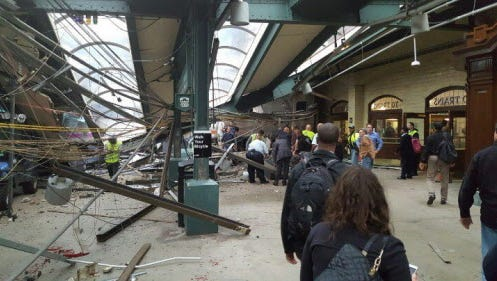 This photo provided by Ian Samuel shows the scene of a train crash in Hoboken, N.J., on Sept. 29, 2016.  A commuter train barreled into the New Jersey rail station during the Thursday morning rush hour, causing serious damage.