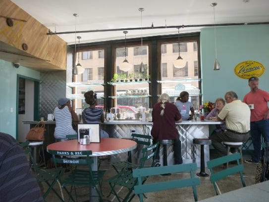 Diners line the counter for breakfast at the new Parks