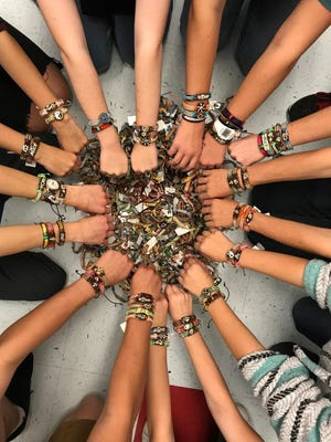 Students wear Yuda Bands to promote their sale as a fundraiser for Prince.