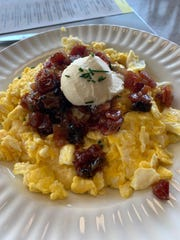 Polenta grits with Gouda cheese, fluffy scrambled eggs and bacon jam, and crowned with a dollop of mascarpone.