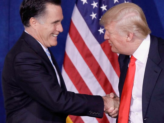 In this Feb. 2, 2012 file photo, Donald Trump greets then-Republican presidential candidate, former Massachusetts Gov. Mitt Romney, after announcing his endorsement of Romney, during a news conference in Las Vegas.