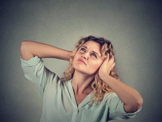 annoyed stressed woman covering ears with hands looking up