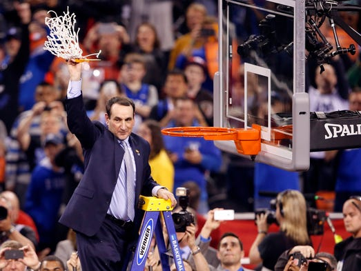Duke Blue Devils head coach Mike Krzyzewski holds up