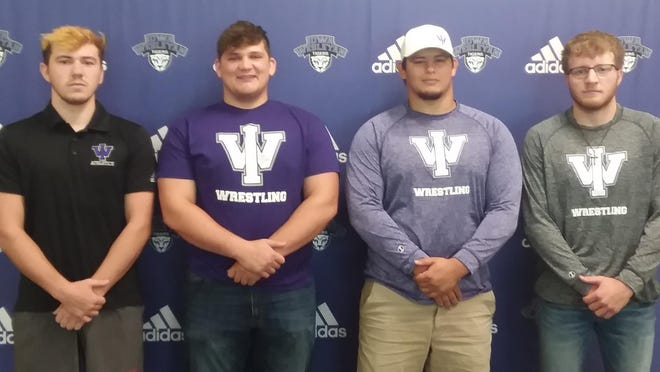 Iowa WesleyanUniversity wrestling recruits, from left Javis Krieger (New London), Keegan Akers (Mediapolis), Brendon Lunsford (Fairfield) and James DeMeyer (Mount Pleasant) are set to open the Tigers' first wrestling season in 30 years.