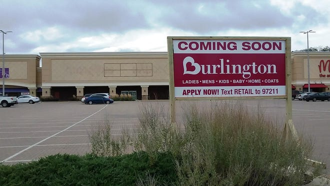 A sign that heralds the opening of a Burlington retail store has been erected at Westlake Shopping Center in Peoria.