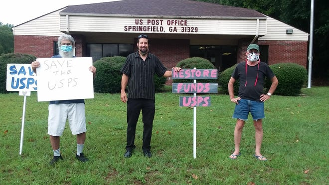 Some people gathered in front of the Springfield post office Tuesday morning in support of funding the U.S. Postal Service.