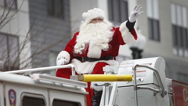 Santa Claus is seen waving to the crowd during the 67th annual Quincy Christmas Parade on Sunday, Dec.1, 2019.  Greg Derr/The Patriot Ledger