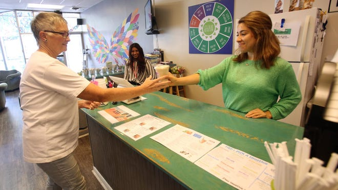 Maira Avalos gives Judy Gaultney a smoothie at Power Up Nutrition in uptown Shelby on Wednesday.