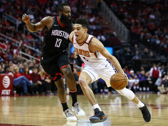 Devin Booker played his second straight game at point