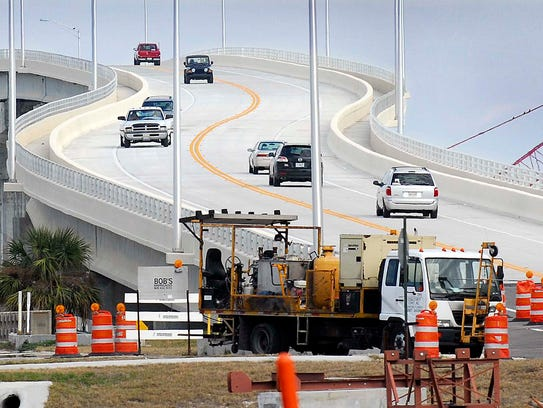 Traffic drives across the newly opened A. Max Brewer