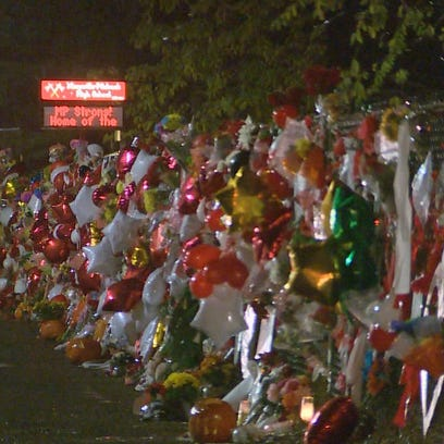 Memorials are placed on the fence outside Marysville-Pilchuck