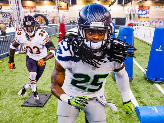 Even cutouts of Chicago Bears cornerback Charles Tillman (left) and Seattle Seahawks cornerback Richard Sherman seem intimidating at the NFL Experience in the Phoenix Convention Center on Friday, Jan. 23, 2015.