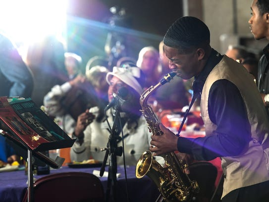 Sincere Hatten plays saxophone during theMayor's Martin