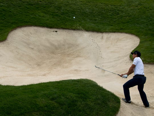 Alex Kang of Las Vegas, Nev., hits out of the bunker