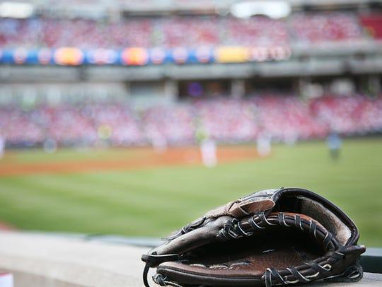 Baseball glove on the wall with a major league stadium