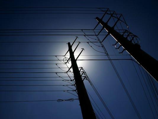 Maze of power lines against deep blue sky