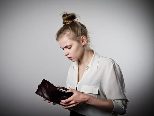 Woman and empty wallet