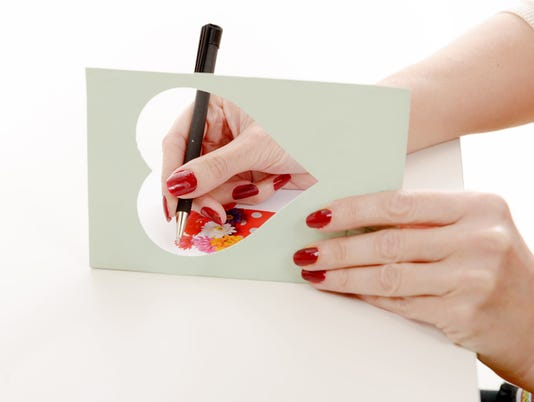 woman writing a greeting card