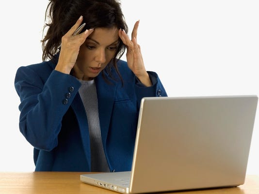 Extremely frustrated businesswoman with laptop on table, close-up