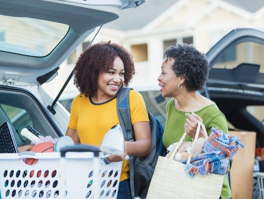 African-American mother helping daughter move