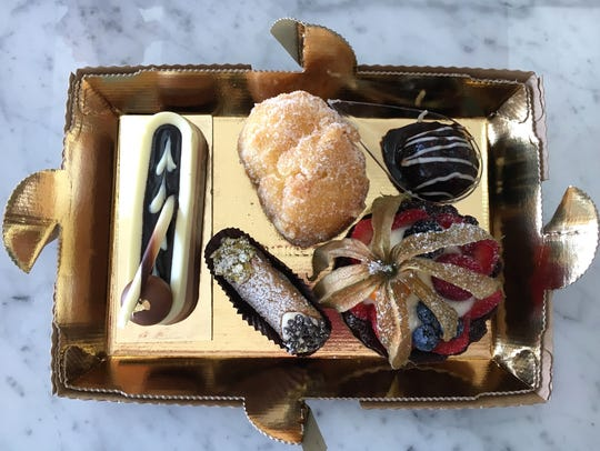 A to-go box of pastries awaits its lid at the Moorpark