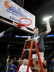 MVP Mike Daum from South Dakota State University hoist the net after the Jackrabbits beat the University of South Dakota Coyotes 97-87 at the 2018 Summit League Basketball tournament at the Denny Sanford Premier Center in Sioux Falls.