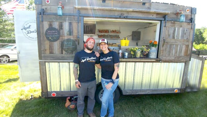 Raritan Township resident Wendy Camella Ferrante is pictured with her husband, Harry, in front of her popular food trailer, Aunt Dee Dee's Old Fashioned Oven Baked Goodness. The business soon will expand into a brick-and-mortar location at 52 Main St. in downtown Flemington.