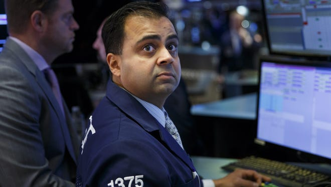 Traders react on the floor of the New York Stock Exchange (NYSE) at the Opening Bell in New York, January 12, 2017.