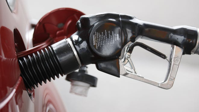 A gas pump nozzle is shown in Wednesday, Aug. 4, 2010, in Portland, Ore.